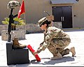 U.S. Army Pfc. Cristina Santillan, with the 3rd Infantry Division, participates in a Memorial Day ceremony at Kandahar Airfield in Kandahar province, Afghanistan, May 27, 2013 130527-A-VM825-041.jpg