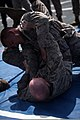 U.S. Marine Corps Cpl. Christopher Smith, top, and Lance Cpl. Branden Cooper, with Security Cooperation Task Force Africa Partnership Station (APS) 2012, practice Marine Corps Martial Arts Program techniques on 120804-M-JU449-075.jpg