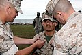 U.S. Marine Corps Staff Sgt. Tomas Perez has new chevrons pinned to his uniform by Capt. Scott Benninghoff, a logistics officer, and Master Sgt. Michael Parker, the Marine Corps Security Cooperation Group 111012-M-WR233-001.jpg
