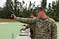 "U.S. Marine Lance Cpl. Jamie Priutt fires his M9 service pistol in the ""Division Matches"" on Camp Hansen, Okinawa, Japan 120131-M-KS710-044.jpg"