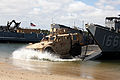 U.S. Marines from Combat Logistics Battalion 8, Transportation Support Company, work together with Navy personnel from Beach Master Unit 2 off-loading ISO containers off a Landing Craft Utility during 120615-M-KS710-150.jpg
