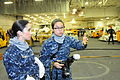 U.S. Navy Mass Communication Specialist Seaman Bounome Chanphouang, right, describes her work aboard the aircraft carrier USS Theodore Roosevelt (CVN 71) to Ensign Eileen Suarez in Norfolk, Va., Jan. 10, 2014 140110-N-YZ252-077.jpg