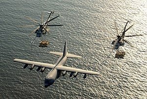 US Navy 030130-M-0000X-001 Two U.S. Marine Corps CH-53E Super Stallion helicopters assigned to Marine Heavy Helicopter Squadron-772 (HMM-772) receive fuel from a KC-130 Hercules.jpg