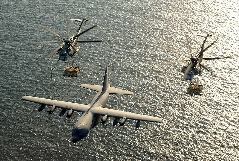 File:US Navy 030130-M-0000X-001 Two U.S. Marine Corps CH-53E Super Stallion helicopters assigned to Marine Heavy Helicopter Squadron-772 (HMM-772) receive fuel from a KC-130 Hercules.jpg