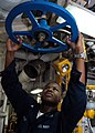 US Navy 030208-N-1512S-007 Machinist's Mate 3rd Class Harold Brent turns a feed water check valve.jpg