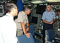 US Navy 030823-N-3349L-003 The Japanese Ambassador to Bahrain, Takao Natusme, left, and the German Ambassador to Bahrain, Wolfgange Lerke, center, are briefed on the capabilities of the attack submarine USS Memphis' (SSN 691).jpg