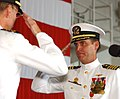 US Navy 030828-N-0696M-032 Capt. Bill Goodwin, right, salutes Capt. James Symonds signifying the official passing of duties and responsibilities to Capt. Symonds as Commanding Officer of USS Ronald Reagan (CVN 76).jpg