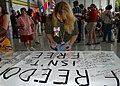 US Navy 030927-N-7535G-010 Donna Reno signs a banner while waiting for her son Lance Corporal Daniel Guiffreda.jpg