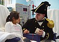 US Navy 040303-N-0335C-009 Lt. William Marks, Executive Officer, USS Constitution, talks about a photo of the 206-year-old warship.jpg