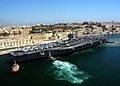 US Navy 040626-N-8704K-002 Tugboats assist the conventionally powered aircraft carrier USS John F. Kennedy (CV 67) while pulling pier-side in the port of Valletta, Malta.jpg