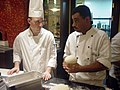 US Navy 041013-N-0180W-004 Radisson Chef instructs Culinary Specialist Seaman Rodney Smith, left, on preparing pizza dough making as part of a Task Force Excel (TFE) Program.jpg