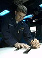 US Navy 041113-N-5834B-041 Aviation Warfare Systems Operator 2nd Class Anthony Denierio, plots maps in the Anti-Submarine Module aboard the Nimitz-class aircraft carrier USS Abraham Lincoln (CVN 72).jpg