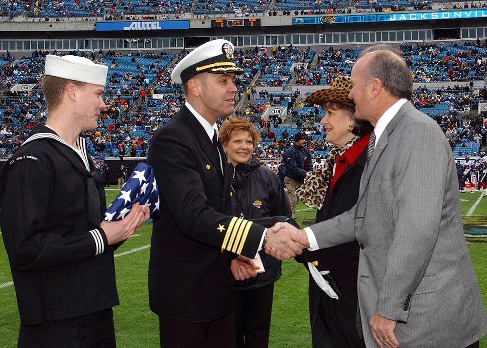 US Navy 041227-N-6631E-001 Commanding officer of the aircraft carrier USS John F. Kennedy (CV 67), Capt. Dennis E. FitzPatrick shakes hands with Jacksonville Jaguar owner Wayne Weaver