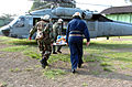 US Navy 050301-N-8629M-016 Military personnel carry an Indonesian patient to a U.S. Navy MH-60S Seahawk helicopter.jpg