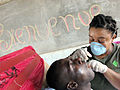 US Navy 050317-N-9594C-008 U.S. Navy Hospital Corpsman 1st Class Jennifer Michalski, assigned to Fleet Hospital Great Lakes, Ill., checks the teeth of a Haitian man during a Navy Medical Readiness Training Exercise in Gonaives.jpg