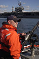 US Navy 050519-G-0000H-001 Coast Guard Petty Officer 3rd Class Sean Campbell, from Winthrop, Mass., mans a M-240 machine gun aboard a rigid hull inflatable boat.jpg
