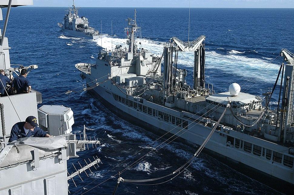 US Navy 050614-N-0167B-050 Sailors aboard USS Kitty Hawk (CV 63) observe a replenishment at sea with Royal Australian Navy auxiliary oiler replenishment ship HMAS Success (AOR 304) as USS Cowpens (CG 63) sails ahead