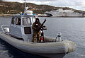 US Navy 060112-N-0780F-006 A Sailor assigned to a harbor patrol unit at the U.S. Naval Support Activity Souda Bay's Security Department mans an M60 7.62 caliber machine gun.jpg
