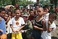 US Navy 060219-M-8084P-067 Commanding Officer of the 31st Marine Expeditionary Unit spends a few moments with children from the area around the devastated town of Guinsahugon.jpg