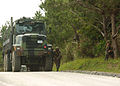 US Navy 060405-N-3560G-022 Members of Naval Mobile Construction Battalion Four (NMCB-4) Seabees conduct convoy immediate action drills during a field exercise in Okinawa's Central Training Area.jpg