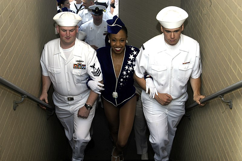 US Navy 060525-N-9640H-030 Sailors escort the Radio City Rockettes to the Top of the Rock Observation Deck at Rockefeller Center, one of many events occurring during Fleet Week New York 2006