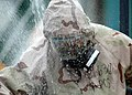 US Navy 070201-N-3019M-007 Hospital Corpsman 1st Class Joseph Calderon, assigned to Naval Branch Health Clinic Sasebo's emergency response team (ERT), goes through a decontamination shower after a mass casualty drill as p.jpg