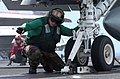 US Navy 070423-N-4420S-043 Aviation Boatswain's Mate Equipment 3rd Class Josh Stonestreet signals to send the catapult forward to prepare an F-A-18C Hornet for launch aboard nuclear-powered aircraft carrier USS Nimitz (CV.jpg