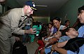 US Navy 070719-N-0194K-408 Capt. Bob Kapcio, mission commander aboard the Military Sealift Command hospital ship USNS Comfort (T-AH 20), hands out stuffed animals during a tour of the Jose Schendal Health Center.jpg
