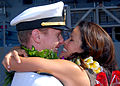 US Navy 070928-N-9758L-121 Lt. Brian Ryglowski, assigned to Ticonderoga-class guided-missile cruiser USS Chosin (CG 65), greets his wife during a traditional first kiss ceremony pierside.jpg