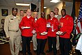 US Navy 071113-N-8102J-379 Team members Culinary Specialist 2nd Class Patrick Faucette, Culinary Specialist 1st Class Preston Charles, Culinary Specialist Seaman Anthony Wilcox and Culinary Specialist 1st Class Robert Jackson J.jpg