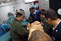 US Navy 071215-N-3659B-234 Medical personnel aboard the aircraft carrier USS Ronald Reagan (CVN 76) help transport a patient into the ship's operating room.jpg