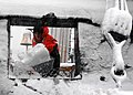 US Navy 080114-N-2893B-001 Seaman Nicole Davis shovels snow through a gun port aboard USS Constitution.jpg