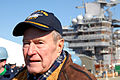 US Navy 080125-N-2510R-005 Former President George H. W. Bush looks down the flight deck of the Precommissioning Unit (PCU) George H.W. Bush (CVN 77) during the ship's catapult testing ceremony.jpg