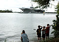 US Navy 080701-N-9076B-002 Children salute the aircraft carrier USS Kitty Hawk as the ship enters Naval Station Pearl Harbor. Kitty Hawk is making a port visit to Pearl Harbor before taking part in exercise Rim of the Pacific 2.jpg