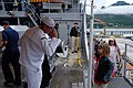 US Navy 080729-N-3483D-001 Boatswain's Mate Seaman Keith Betro salutes a little girl while standing quarterdeck watch.jpg