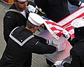 US Navy 080803-N-4774B-311 Sailors aboard amphibious assault ship USS Tarawa (LHA 1) perform a burial at sea.jpg