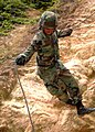 US Navy 081027-N-8816D-392 Equipment Operator 3rd Class Jose Alemanacevedo uses a 120 foot assault rope to repel down a 50 foot cliff.jpg