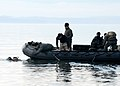US Navy 090204-N-9860Y-002 Sailors from Explosive Ordnance Disposal Mobile Unit (EODMU) 11 conducts a simulated underwater mine removal in Crescent Harbor.jpg