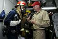 US Navy 090527-N-7478G-112 Lt. j.g. Jeffrey Hanson, assistant damage control officer aboard the amphibious command ship USS Blue Ridge (LCC 19), instructs scene leader Hull Maintenance Technician 3rd Class Christopher Leddy.jpg