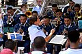 US Navy 090626-N-9318F-139 Air Forces Southern Band director Capt. Christina Moore-Uritia leads an integrated performance with members of an El Salvadoran military band during a Continuing Promise 2009 medical community service.jpg