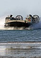 US Navy 090723-N-9418A-250 A Landing Craft, Air Cushion vehicle enters Freshwater Bay to on-load Marines and cargo to the forward-deployed amphibious assault ship USS Essex (LHD 2) after completing Talisman Saber 09 exercise.jpg
