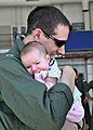 US Navy 090729-N-1924T-018 Lt. Ryan Harris embraces his newborn daughter during a homecoming celebration at Naval Air Station Oceana.jpg