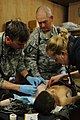 US Navy 100119-F-2222C-128 Navy medical personnel tend to a gun shot wound.jpg