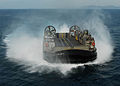 US Navy 100201-N-2218S-095 A landing craft air cushion vehicle approaches the stern gate of the forward-deployed amphibious assault ship USS Essex (LHD 2) to on-load Marines.jpg