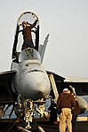 US Navy 100711-N-6362C-304 Sailors perform maintenance on a Super Hornet aboard USS Harry S. Truman.jpg