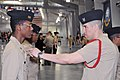 US Navy 110312-N-IK959-433 Boatswain's Mate 2nd Class Daniel Muniz, right, inspects a Navy Junior ROTC cadet.jpg