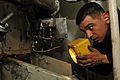 US Navy 110406-N-NL541-091 ngineman 2nd Class Justin Davila, assigned to the guided-missile frigate USS Boone (FFG 28), uses a flashlight to inspec.jpg