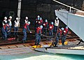 US Navy 110412-N-5538K-522 Sailors assigned to the forward-deployed amphibious assault ship USS Essex (LHD 2) carry chains onto a landing craft uti.jpg