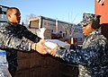 US Navy 120118-N-BJ178-030 Logistics Specialist Seaman Maurice Noland, left, and Seaman Gerald Coriolan, both assigned to USS Constitution, unload.jpg