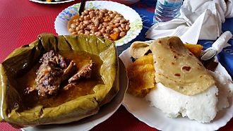 East African Highland bananas - Ugandan traditional meal with Matoke steamed and served with luwombo, meat or gnuts steamed in banana leaves.